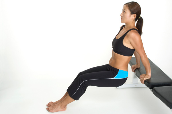 Woman doing dips workout